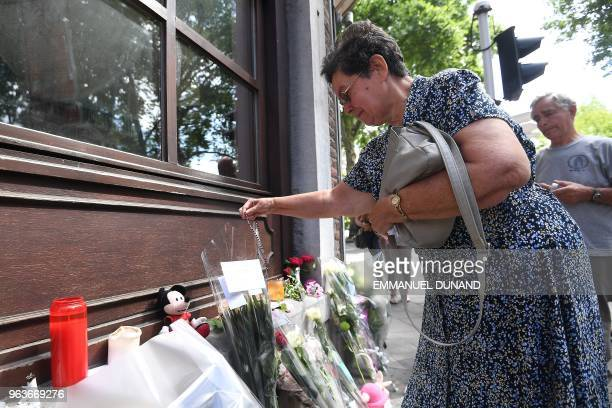 Bernadette Hennart the mother of killed policewoman Soraya Belkacemi pays tribute to her daughter on May 30 in Liege at a makeshift altar situated...