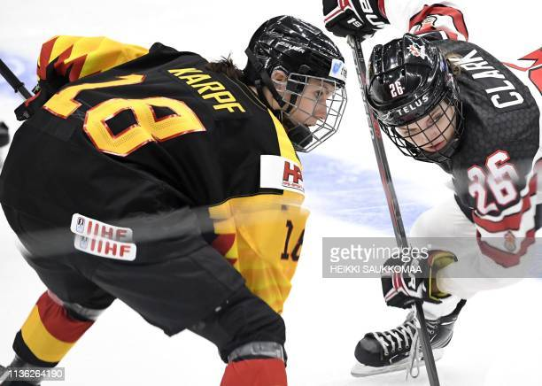 Bernadette Karpf of Germany vies with Emily Clark of Canada during the quarterfinal match Canada vs Germany of the IIHF Women's Ice Hockey World...