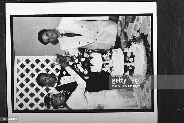 Bernadette LockeMattox asst basketball coach at Univ of KY clad in wedding dress w her new husband Vince Mattox her boss KY's head coach Rick Patino...