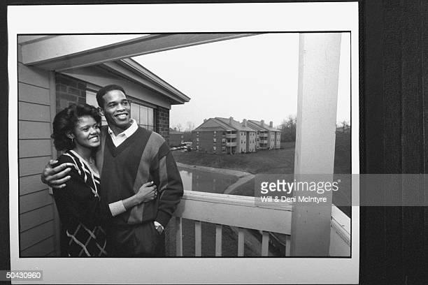 Bernadette LockeMattox asst basketball coach at Univ of KY cuddling happily w her husband Vince Mattox a consultant to the Kentuck Dept of Education...