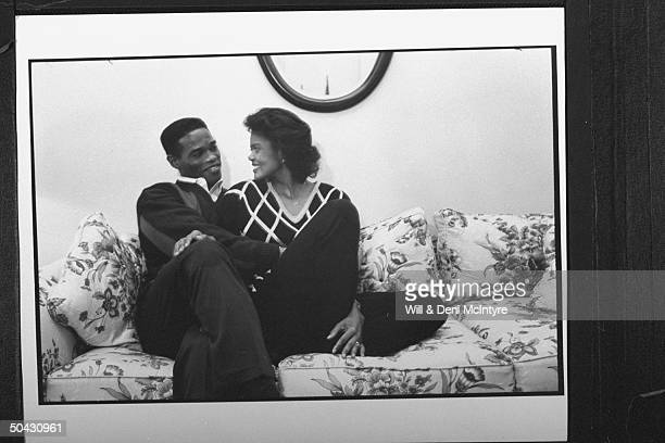 Bernadette LockeMattox asst basketball coach at Univ of KY cuddling happily on couch w her husband Vince Mattox a consultant to the Kentuck Dept of...