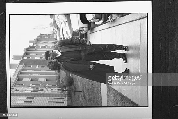 Bernadette LockeMattox asst basketball coach at Univ of KY kissing her husband Vince Mattox before leaving for work as they stand on sidewalk in...