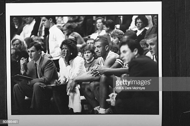 Bernadette Locke-Mattox, asst. Basketball coach at Univ. Of KY , shouting instructions while sitting on bench w. Asst. Coach Billy Donovan as head...