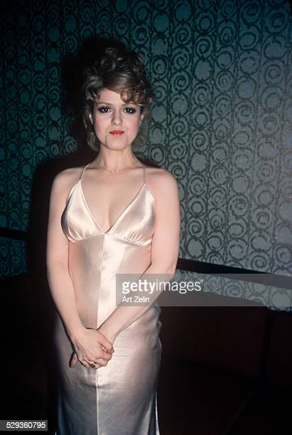 Bernadette Peters in a white sheath dress circa 1970 New York
