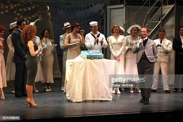 Bernadette Peters surprises Joel Grey on his 80th birthday with a cake backstage at Anything Goes at the Stephen Sondheim Theatre in New York City on...