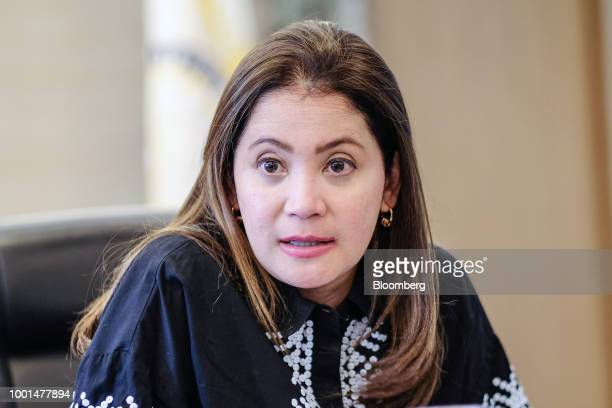 Bernadette RomuloPuyat the Philippines' secretary of tourism stands for a photograph in the Makati district of Manila the Philippines on Monday July...