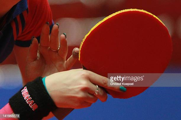 Bernadette Szocs of Romania holds her racket during her match against Alexandra Privalova of Belarus during the LIEBHERR table tennis team world cup...