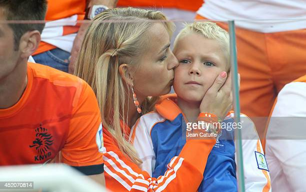 Bernadien Eillert Robben wife of Arjen Robben and their son Luka Robben attend the 2014 FIFA World Cup Brazil Semi Final match between Netherlands...