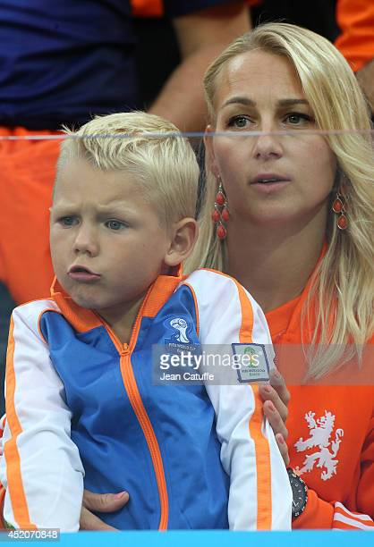 Bernadien Eillert Robben wife of Arjen Robben and their son Luka Robben attend the 2014 FIFA World Cup Brazil Semi Final match between Netherlands...