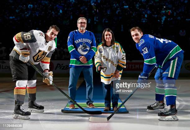Bernadine and Toby Boulet parents of former Humbolt Broncos player Logan Boulet drop the puck for Bo Horvat of the Vancouver Canucks and Reilly Smith...