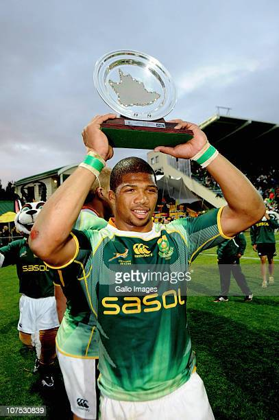Bernado Botha of South Africa celbrates with the trophy after winning the Plante final against Argentina on day 2 of the HSBC Sevens World Series...