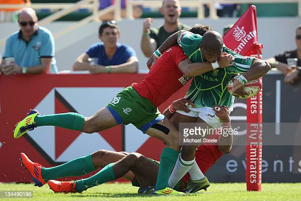Bernado Botha of South Africa scores a try despite the challenge from Goncalo Foro of Portugal during the match between South Africa and Portugal on...