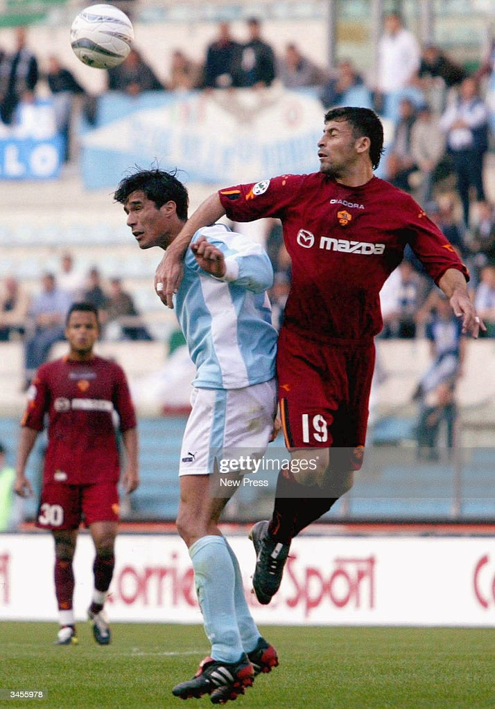 Bernado Corradi (L) and Walter Samuel jump for a header during the Serie A match between Roma and Lazio on April 21, 2004 in Rome Italy. The match ended in a 1-1 draw. (Photo by Newpress/Getty Images).