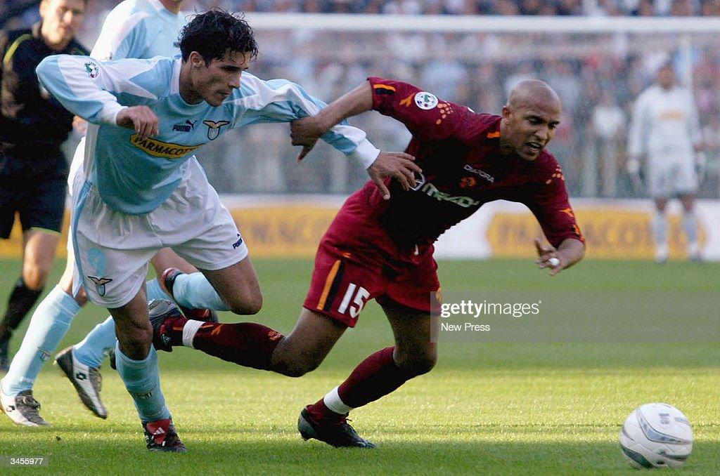 Bernado Corradi (L) fends off Olivier Dacourt during the Serie A match between Roma and Lazio on April 21, 2004 in Rome Italy. The match ended in a 1-1 draw. (Photo by Newpress/Getty Images).
