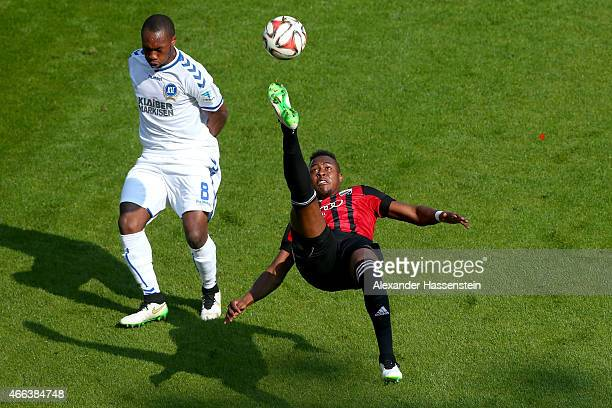 Bernado De Oliveira of Ingolstadt battles for the ball with Reinhold Yamada of Karlsruhe during the Second Bundesliga match between FC Ingolstadt and...