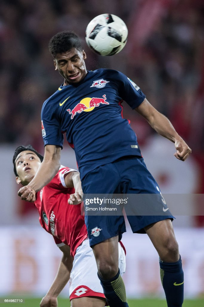 Bernado of Leipzig jumps for a header with Yoshinori Muto of Mainz during the Bundesliga match between 1. FSV Mainz 05 and RB Leipzig at Opel Arena on April 5, 2017 in Mainz, Germany.