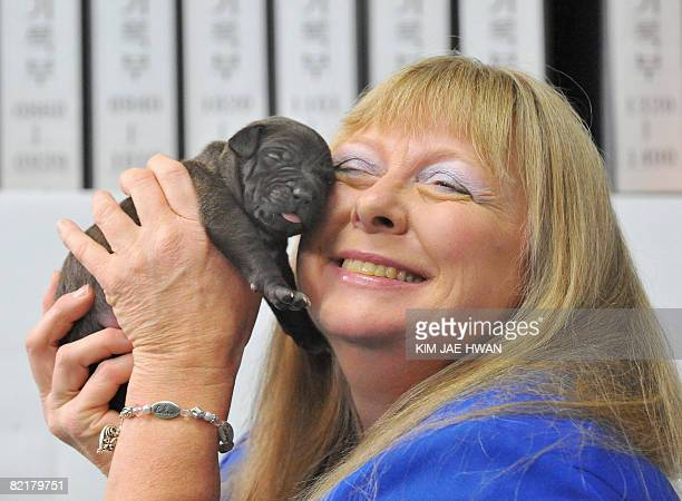 Bernann McKinney from Hollywood California smiles as she holds up a clone of her late beloved former pitbull terrier at the Seoul National University...