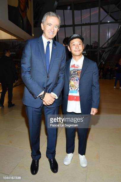 Bernard Arnault and Yusaku Maezawa attend the Opening Of The New Exhibitions JeanMichel Basquiat And Egon Schiele At The Fondation Louis Vuitton at...