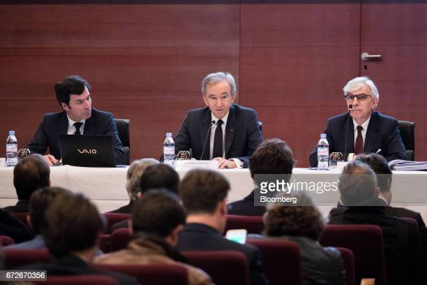 Bernard Arnault billionaire and chief executive officer of LVMH Moet Hennessy Louis Vuitton SE center speaks as Florian Ollivier chief financial...