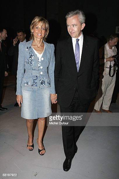 Bernard Arnault CEO and President of Dior's parent group LVMH and his wife pianist Helene Mercier Arnault attend the Dior's Men fashion Showdesigned...