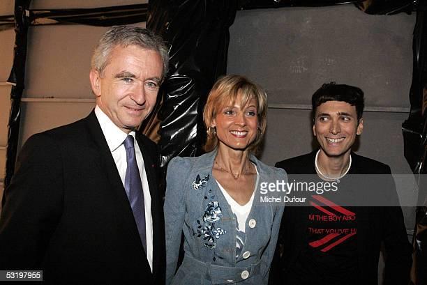 Bernard Arnault CEO and President of Dior's parent group LVMH his wife pianist Helene Mercier Arnault and designer Heidi Slimane attend the Dior's...
