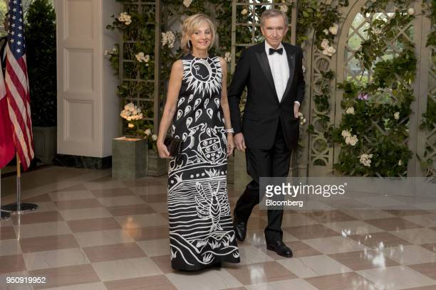Bernard Arnault chief executive officer of LVMH Moet Hennessy Louis Vuitton SE right and Helene Arnault arrive for a state dinner in honor of French...