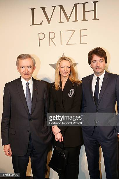 Bernard Arnault Delphine Arnault and Antoine Arnault attend LVMH Prize SemiFinalists Designers Cocktail Party on February 26 2014 in Paris France