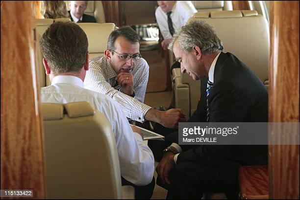 Bernard Arnault on board his private jet between Beijing and Shanghai. In Shanghai, China on October 11, 2004 - With his board: from left to right:...