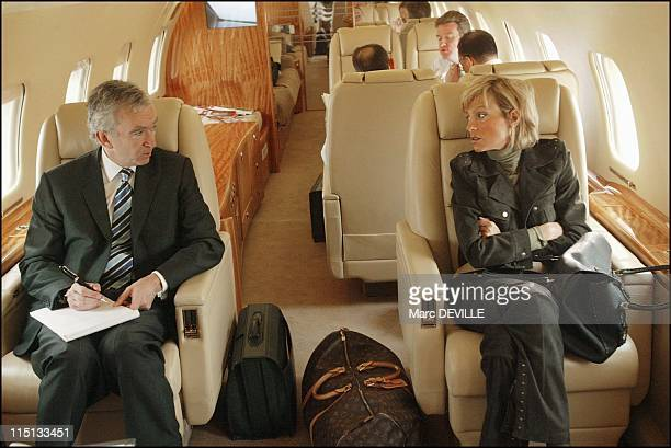 Bernard Arnault on board his private jet between Beijing and Shanghai. In Shanghai, China on October 11, 2004 - Bernard Arnault and his wife in...