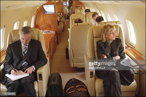 Bernard Arnault on board his private jet between Beijing and Shanghai. In Shanghai, China on October 11, 2004 - Bernard Aranult and his wife in...