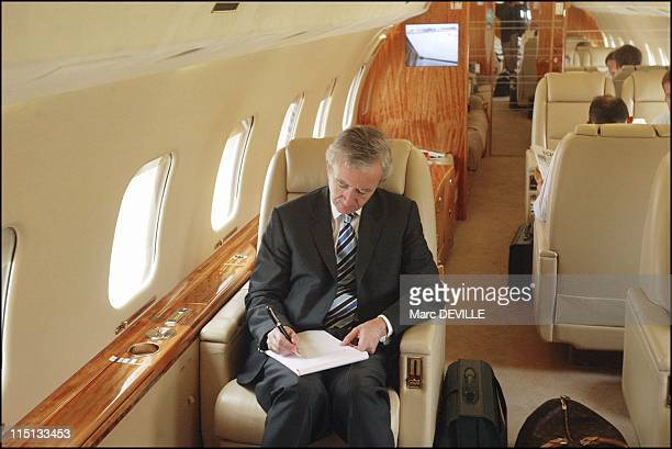 Bernard Arnault on board his private jet between Beijing and Shanghai. In Shanghai, China on October 11, 2004.