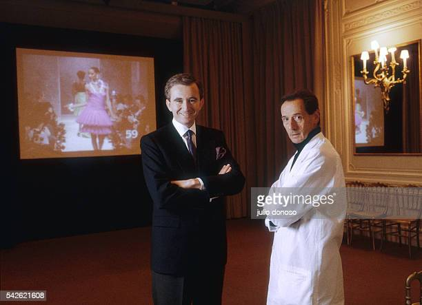 Bernard Arnault president of LVMH and designer Marc Bohan stand backstage during the 1987 Christian Dior springsummer fashion show Bohan took over as...