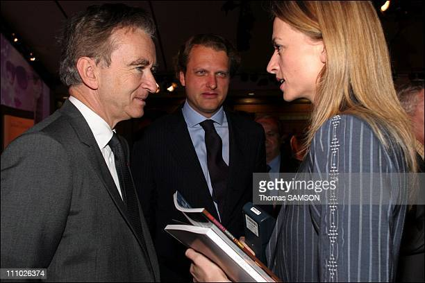 Bernard Arnault president of the LVMH group Delphine Arnault and her husband Alessandro Vallarino Gancia in Paris France on May 11th 2006