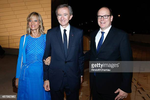 Bernard Arnault standing between his wife Helene Arnault and Prince Albert of Monaco attend the Foundation Louis Vuitton Opening at Foundation Louis...