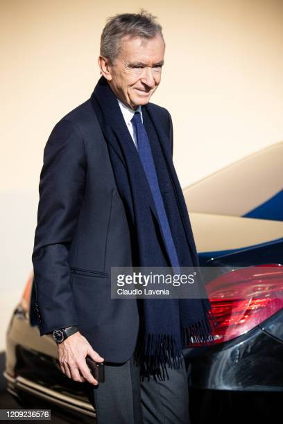 Bernard Arnault, wearing a blue blazer, grey pants, blue scarf, blue tie and white shirt, is seen outside Dior, during Paris Fashion Week -...