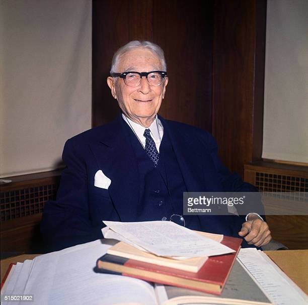 Bernard Baruch, an American stockbroker, public official, and finally, advisor for Presidents from Woodrow Wilson to John F. Kennedy is seen on his...