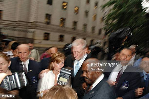 Bernard 'Bernie' Ebbers former CEO of WorldCom center with his wife Kristie leaves Federal Court in New York Wednesday July 13 2005 after being...
