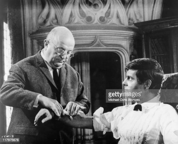 Bernard Blier handles Louis Jourdan's arm in a scene from the film 'To Commit a Murder' 1967