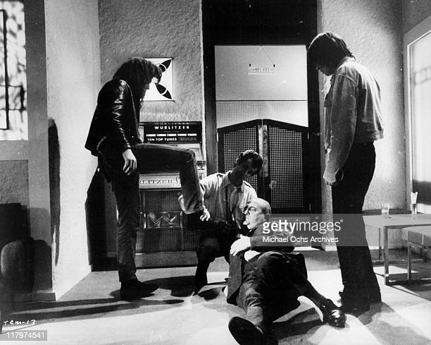 Bernard Blier runs into some trouble at a cafe in a scene from the film 'To Commit a Murder' 1967