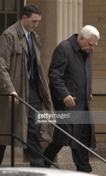 Bernard Cardinal Law, right, departs the chancery library after being deposed on May 13, 2002. At left is Wilson Rogers III, a lawyer representing...