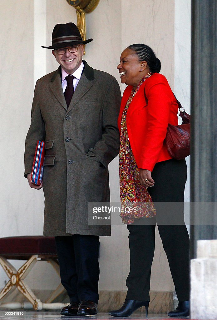 Bernard Cazeneuve, French Minister of the Interior and Christiane Taubira, Keeper of the Seals, Minister of Justice leave after the weekly cabinet meeting at the Elysee Presidential Palace on January 4, 2016 in Paris, France. It is the first cabinet meeting of the year 2016.