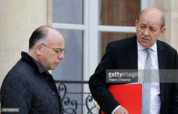 Bernard Cazeneuve French Minister of the Interior and Jean Yves Le Drian French Minister of Defence leave the Elysee Palace after a security meeting...