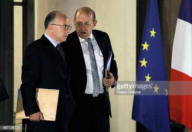 Bernard Cazeneuve French Minister of the Interior and Jean Yves Le Drian French Minister of Defence leave the Elysee Palace after a crisis cabinet...