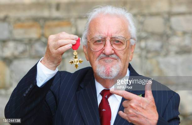 Bernard Cribbins poses with his Officer of the British Empire medal after receiving it during an Investiture ceremony with the Princess Anne Princess...