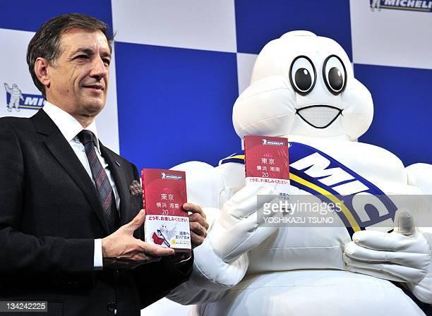 Bernard Delmas Nihon Michelin Tire president and Michelin's mascot Bibendum display the new edition of their guide book 'Michelin guide Tokyo...