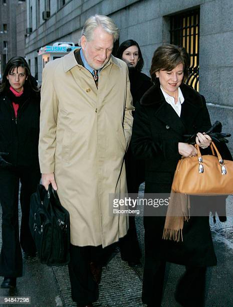 Bernard Ebbers former CEO of Worldcom leaves Manhattan Federal Court accompanied by his wife Kristie and daughters after opening statements in his...