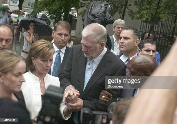 Bernard Ebbers former chairman of WorldCom center leaves federal court with his wife Kristie Wednesday July 13 in New York Ebbers was sentenced to 25...