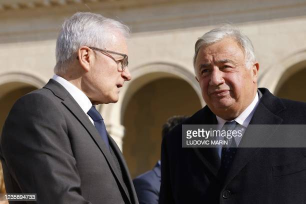Bernard Emie, Director of the Directorate-General for External Security speaks with French Senate president Gerard Larcher during a national memorial...