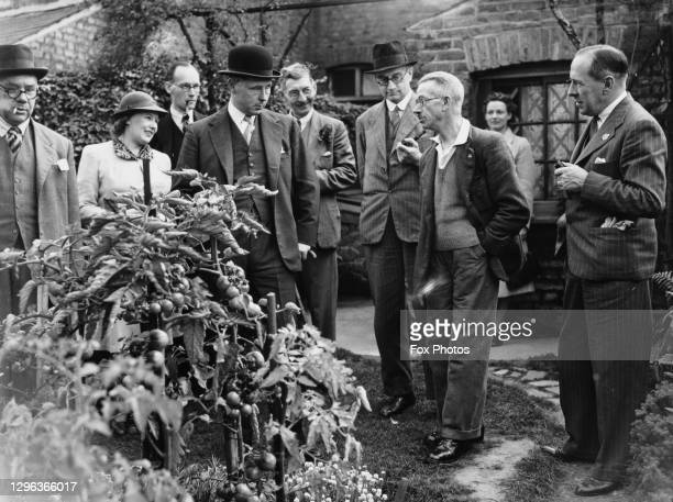 Bernard Fitzalan-Howard, 16th Duke of Norfolk and Parliamentary Secretary to the Ministry of Agriculture and Fisheries on a visit to inspect gardens...