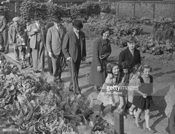 Bernard FitzalanHoward 16th Duke of Norfolk visits a former children's playground in Bethnal Green London where the local people have dug up the...